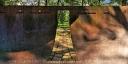 Mahnmahl im Hammerpark - Das Mahnmal von Hans Kupelwieser versinnbildlicht eine Opferschale. Die durch eine Öffnung begehbare Plastik ist 2m hoch und 4m im Durchmesser. Das Innere ist als Meditationsraum gedacht. Durch die Höhe von etwa 2m werden alle störenden Einflüsse abgeschirmt, nach oben hin ist aber freie Sicht auf den Himmel und die Bäume gegeben. Nur in Augenhöhe strömt Licht in 13 Öffnungen, die als Zeichen für die Widerstandskämpfer stehen. Unter den Öffnungen sind die Namen der Opfer zu lesen
